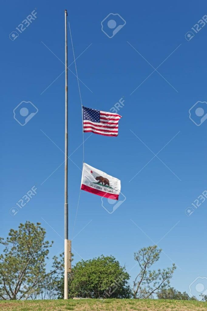 57497714 Us And California Flags Flying At Half Mast On A Hill Top With Blue Sky Background 682x1024