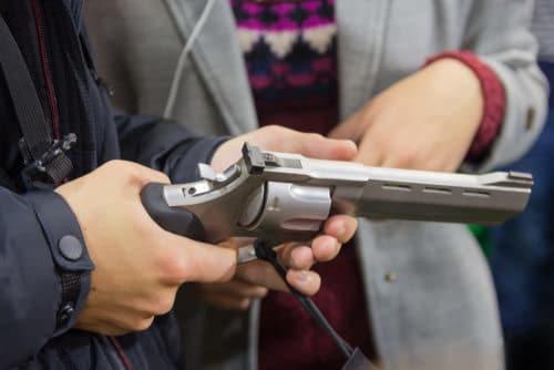 Man Holding Gun Revolver Ss